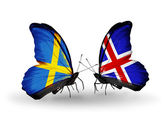 Two butterflies with flags on wings as symbol of relations Sweden and Iceland — Stock Photo
