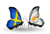 Two butterflies with flags on wings as symbol of relations Sweden and Cyprus — Stock Photo