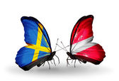 Two butterflies with flags on wings as symbol of relations Sweden and Latvia — Stock Photo