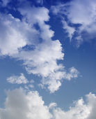 The blue sky with clouds, background — Stock Photo