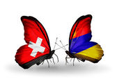 Two butterflies with flags of Switzerland and Armenia on wings — Foto de Stock