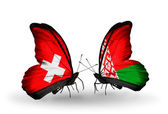 Two butterflies with flags of Switzerland and Belarus on wings — Stock Photo