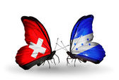 Two butterflies with flags of Switzerland and Honduras on wings — Stock fotografie
