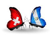Deux papillons avec des drapeaux de la suisse et le guatemala sur les ailes — Photo