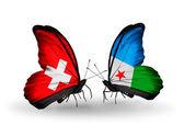 Dva motýli s vlajkami švýcarska a džibuti na křídlech — Stock fotografie