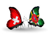 Two butterflies with flags of Switzerland and Dominica on wings — Stock Photo
