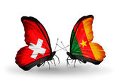 Two butterflies with flags of Switzerland and Cameroon on wings — Stock Photo