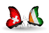 Two butterflies with flags of Switzerland and Cote Divoire on wings — Foto Stock