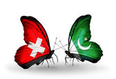 Two butterflies with flags of Switzerland and Pakistan on wings — Stock Photo