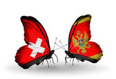 Two butterflies with flags on wings as symbol of relations Switzerland and Montenegro — Foto de Stock