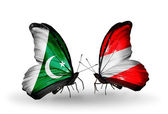 Two butterflies with flags of Pakistan and Austria on wings — Stock Photo