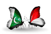 Dos mariposas con banderas de pakistán y mónaco, indonesia en alas — Foto de Stock