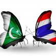 Stock Photo: Two butterflies with flags of Pakistand Thailand on wings