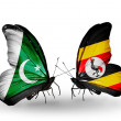 Stock Photo: Two butterflies with flags of Pakistand Ugandon wings
