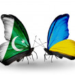 Stock Photo: Two butterflies with flags of Pakistand Ukraine on wings