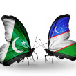 Stock Photo: Two butterflies with flags of Pakistand Uzbekiston wings