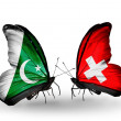 Stock Photo: Two butterflies with flags of Pakistand Switzerland on wings