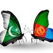 Stock Photo: Two butterflies with flags of Pakistand Eritreon wings