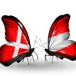 Stock Photo: Two butterflies with flags of Denmark and Austrion wings