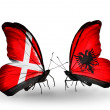 Stock Photo: Two butterflies with flags of Denmark and Albanion wings