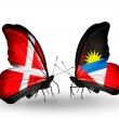 Stock Photo: Two butterflies with flags of Denmark and Antiguand Barbudaon wings