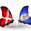 Stock Photo: Two butterflies with flags of Denmark and Argentinon wings