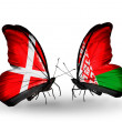 Stock Photo: Two butterflies with flags of Denmark and Belarus on wings