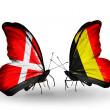 Stock Photo: Two butterflies with flags of Denmark and Belgium on wings