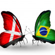 Stock Photo: Two butterflies with flags of Denmark and Brazil on wings