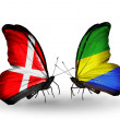 Stock Photo: Two butterflies with flags of Denmark and Gabon on wings
