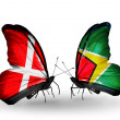 Stock Photo: Two butterflies with flags of Denmark and Guyanon wings