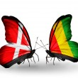 Stock Photo: Two butterflies with flags of Denmark and Guineon wings
