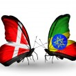 Stock Photo: Two butterflies with flags of Denmark and Ethiopion wings