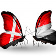 Stock Photo: Two butterflies with flags of Denmark and Yemen on wings