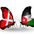 Stock Photo: Two butterflies with flags of Denmark and Jordon wings
