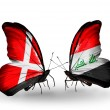 Stock Photo: Two butterflies with flags of Denmark and Iraq on wings
