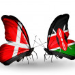 Stock Photo: Two butterflies with flags of Denmark and Kenyon wings