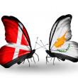 Stock Photo: Two butterflies with flags of Denmark and Cyprus on wings