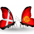 Stock Photo: Two butterflies with flags of Denmark and Kirghiz on wings