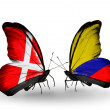 Stock Photo: Two butterflies with flags of Denmark and Columbion wings