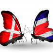 Stock Photo: Two butterflies with flags of Denmark and CostRicon wings