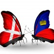 Stock Photo: Two butterflies with flags of Denmark and Liechtenstein on wings