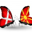 Stock Photo: Two butterflies with flags of Denmark and Macedonion wings