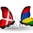 Stock Photo: Two butterflies with flags of Denmark and Mauritius on wings