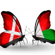 Stock Photo: Two butterflies with flags of Denmark and Madagascar on wings
