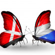 Stock Photo: Two butterflies with flags of Denmark and Luxembourg on wings