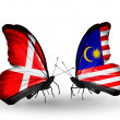 Stock Photo: Two butterflies with flags of Denmark and Malaysion wings