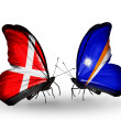 Stock Photo: Two butterflies with flags of Denmark and Marshall islands on wings