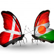 Stock Photo: Two butterflies with flags of Denmark and Niger on wings