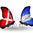 Stock Photo: Two butterflies with flags of Denmark and Nicaraguon wings
